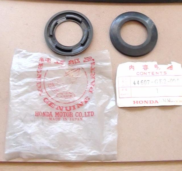 Tapa de plástico embellecedor disco de freno Honda